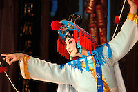 A performer at the Lao She Tea House in Beijing. Named after the Chinese author, Lao She, it is a traditional style tea-house with nightly entertainment of Beijing Opera. Originally staged for the royal family, Beijing Opera (or Peking Opera) has existed for over 200 years. It consists of short performances of comedy, singing, music, acrobats, kung fu, and traditional Chinese opera..