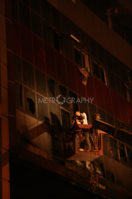SULAYMANIYAH, IRAQ: Fireman use a ladder to rescue a child from the Soma Hotel on July 15, 2010...At least 41 people, including several foreign nationals, died in a hotel fire in the city of Sulaymaniyah in northern Iraq.  Another 23 people were injured in the fire on Thursday at the Soma Hotel in the central area of the city.<br /> <br /> Photo by Rawsht Twana