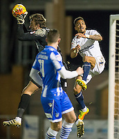 Goalkeeper Sam Walker of Colchester United saves from Paris Cowan-Hall of Wycombe Wanderers during the Sky Bet League 2 match between Colchester United and Wycombe Wanderers at the Weston Homes Community Stadium, Colchester, England on 21 February 2017. Photo by Andy Rowland / PRiME Media Images.