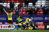Oxford United players celebrate by jumping onto Ryan Ledson after he scored their third goal during Charlton Athletic vs Oxford United, Sky Bet EFL League 1 Football at The Valley on 3rd February 2018