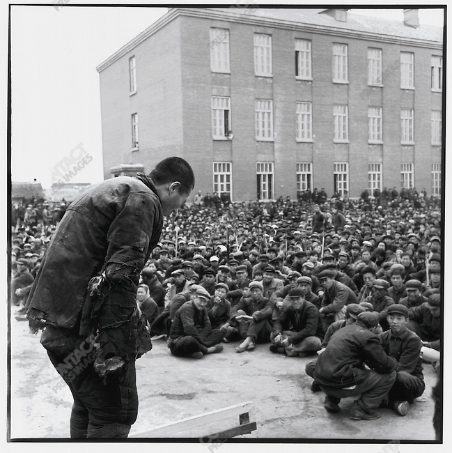 """Denounced as a rich peasant, Deng Guoxing bows before a sea of accusers during a three-hour long """"struggle session."""" Ashihe commune, Acheng county, 12 May 1965"""