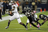 25 October 2011:  FIU defensive back Jose Cheeseborough (27) tackles Troy wide receiver Eric Thomas (3) in the first quarter as the FIU Golden Panthers defeated the Troy University Trojans, 23-20 in overtime, at FIU Stadium in Miami, Florida.