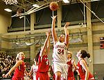 02/11/11--Clackamas senior Jen Reese shoots the ball over Oregon City defenders at Clackamas High School..Photo by Jaime Valdez