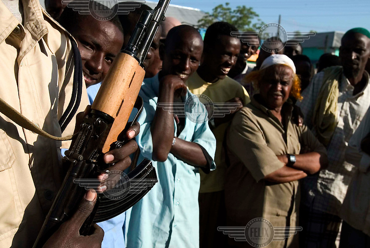 Locals mingle with fighters loyal to the transitional government (TFG) a day after they took the town of Buurhakaba. Backed by the Ethiopian military, TFG troops quickly captured territory previously held by the Union of Islamic Courts (UIC).