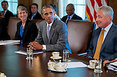 United States President Barack Obama, center, pauses while speaking during a cabinet meeting at the White House with U.S. Secretary of the Interior Sally Jewell, left, and U.S. Secretary of Defense Chuck Hagel, right,  in Washington, D.C., U.S., on Tuesday, July 1, 2014. Obama said yesterday he'll go it alone on changing U.S. immigration rules because House Republicans won't act. <br /> Credit: Andrew Harrer / Pool via CNP