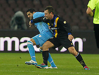 Miguel Britos   Antonio Cassano  in action during the Italian Serie A soccer match between SSC Napoli and Parma FC at San Paolo stadium in Naples
