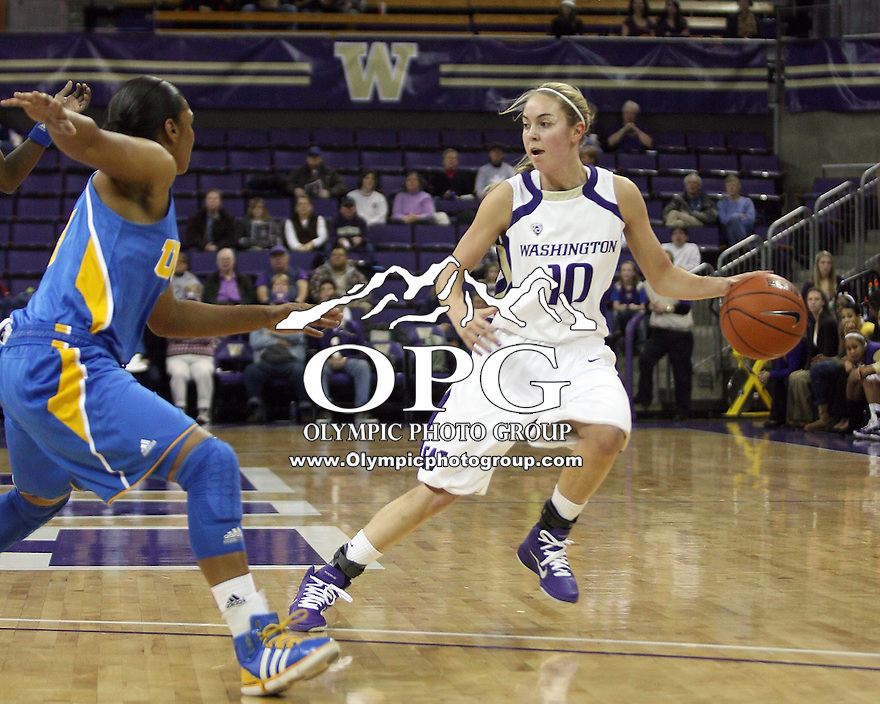 December 31, 2010:  Washington Huskies guard #10 Kristi Kingma drives to the basket against UCLA.  UCLA defeated Washington 60-48 at Hec Ed Arena in Seattle, WA.