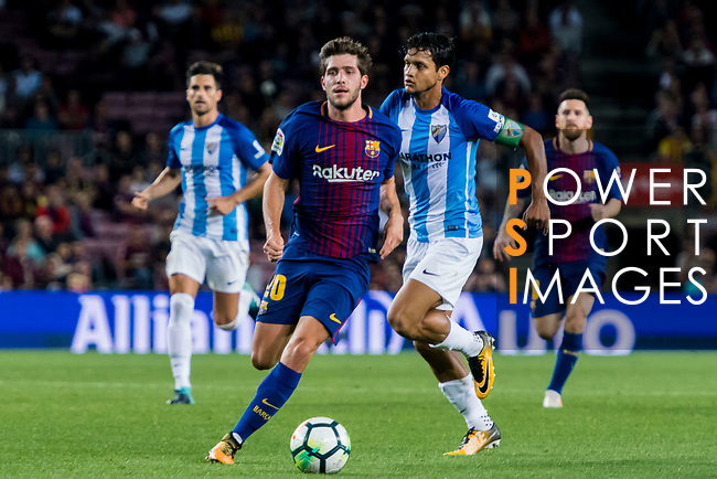 Sergi Roberto Carnicer (l) of FC Barcelona in action during the La Liga 2017-18 match between FC Barcelona and Malaga CF at Camp Nou on 21 October 2017 in Barcelona, Spain. Photo by Vicens Gimenez / Power Sport Images