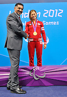 LONDON, ENGLAND 09/07/2012  Valerie Grand'Maison receiving her Gold Medal from the Minister of State (Sport) Bal Gosal for the 200m Individual Medley at the London 2012 Paralympic Games in the Aquatics Centre.  (Photo by Matthew Murnaghan/Canadian Paralympic Committee)