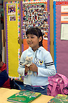 "Oakland CA 2nd grader presenting stuffed animal to class during ""show and tell"" on ""Bring your Teddy Bear to School Day"""