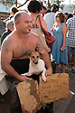 Entrant with dog after finishing. Christmas Eve dog races from Scotland Island to Church Point, Sydney, New South Wales