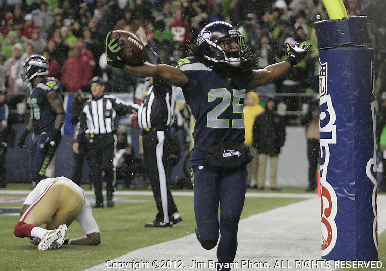 Seattle Seahawks  cornerback Richard Sherman (25) celebrates a pass interception against the San Francisco 49ers at CenturyLink Field in Seattle, Washington on December 23, 2012.  Seahawks beat the 49ers 42-13.   ©2012. Jim Bryant Photo. All Rights Reserved.