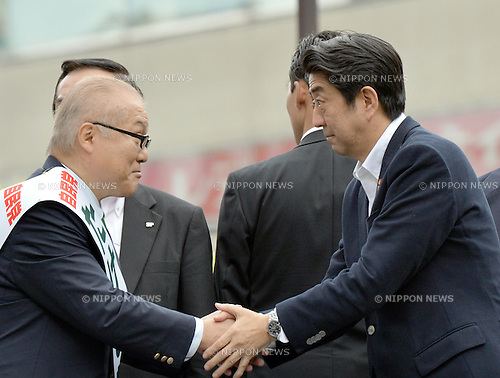July 4, 2013, Tokyo, Japan - Japan's Prime Minister Shinzo Abe, right, shakes hands with local candidate Keizo Takemi on his stumping tour through Tokyo's Ikebukuro area on Thursday, July 4, 2013, as campaigning for the July 21 upper house election officially kicks off. <br /> <br /> Contested are half the 242seats in less powerful upper house of parliament that could make or break the Abe administration and Abenomics, his economic-revival plan.  (Photo by Natsuki Sakai/AFLO)