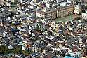 September 5, 2012, Tokyo, Japan - A cluster of decrepit houses stand side by side along narrow allies barely wide enough for fire engines to squeeze through in the densely populated Ichiterakototoi area of Tokyo's downtown Sumida ward on Wednesday, September 5, 2012.  In 1979, the district government led the country with its project to rebuild the areas crammed with wooden buildings to mitigate possible catastrophic fires. With only 40.7 percent of the areas made up of fire-resistant buildings and empty lots, the vast majority of the district, considered at high risk of fire and building collapse, could be burned to the ground if a catastrophic earthquake were to strike the nation's capital.  (Photo by Natsuki Sakai/AFLO) AYF -mis-