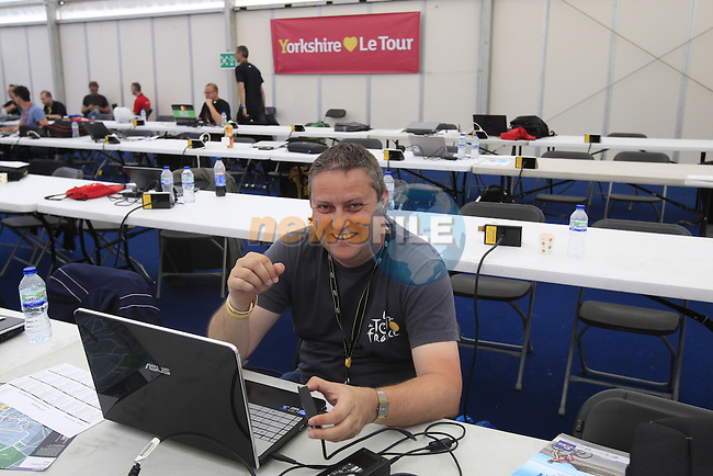 Swiss photographer Heinz Zwicky hard at work in the media centre before the Grand Depart of the 2014 Tour de France. 4th July 2014.<br /> Picture: Eoin Clarke www.newsfile.ie