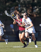 Boston College midfielder Kara Magley (11) brings the ball forward as Harvard University defender Amelia Capone (5) pressures.
