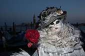 Venice, Italy. Carnival in Venice at dusk. People dress in costumes and wear masks as they celebrate the 2015 Carnival in Venice, Italy.