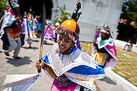 """Members of a dance group """"Los Historiantes"""" perform the Dance of the Moors and Christians during the Flower & Palm Festival in Panchimalco, El Salvador, 8 May 2011. On the first Sunday of May, the small town of Panchimalco, lying close to San Salvador, celebrates its two patron saints with a spectacular festivity, known as """"Fiesta de las Flores y Palmas"""". The origin of this event comes from pre-Columbian Maya culture and used to commemorate the start of the rainy season. Women strip the palm branches and skewer flower blooms on them to create large colorful decoration. In the afternoon procession, lead by a male dance group performing a religious dance-drama inspired by the Spanish Reconquest, large altars adorned with flowers are slowly carried by women, dressed in typical costumes, through the steep streets of the town."""