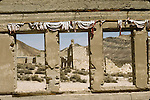 Windows with tattered draperies, Rhyolite, Nev.