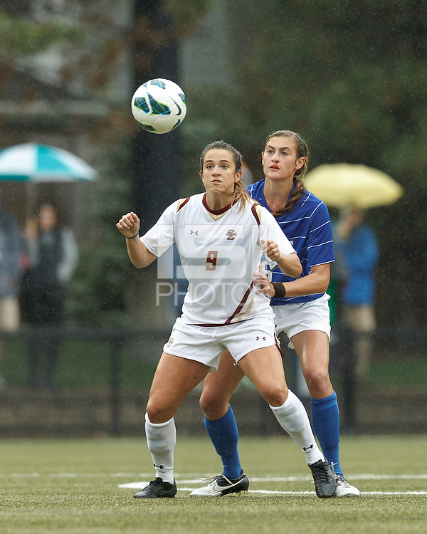 Boston College forward Stephanie McCaffrey (9) traps the ball as Duke University defender Lizzy Raben (6) pressures.Boston College (white) defeated Duke University (blue/white), 4-1, at Newton Campus Field, on October 6, 2013.