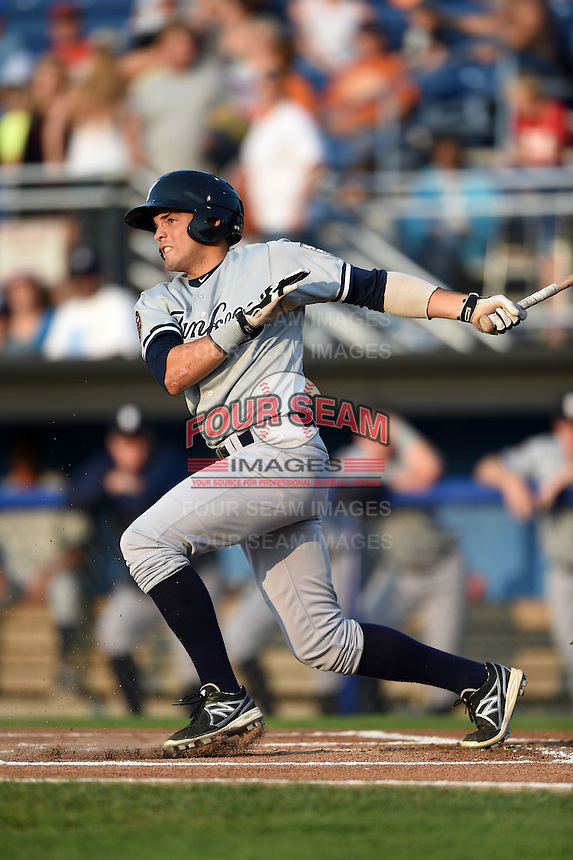 Staten Island Yankees shortstop Vicente Conde (12) at bat during a game against the Batavia Muckdogs on August 8, 2014 at Dwyer Stadium in Batavia, New York.  Staten Island defeated Batavia 4-2.  (Mike Janes/Four Seam Images)