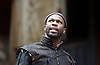 The Merchant of Venice <br /> by William Shakespeare <br /> at The Globe Theatre, London, Great Britain <br /> 25th April 2015 <br /> <br /> <br /> <br /> <br /> Stefan Adegbola as Launcelot Gobbo<br /> <br /> <br /> <br /> Photograph by Elliott Franks <br /> Image licensed to Elliott Franks Photography Services