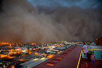 Apr. 26, 2011; Phoenix, AZ, USA; A dust storm converges on downtown Phoenix  haboob sandstorm dust monsoon storm chaser chasing city dusk Arizona father daughter family urban
