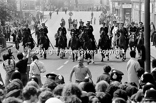 Playing up for the cameras Lewisham, London.1977<br />