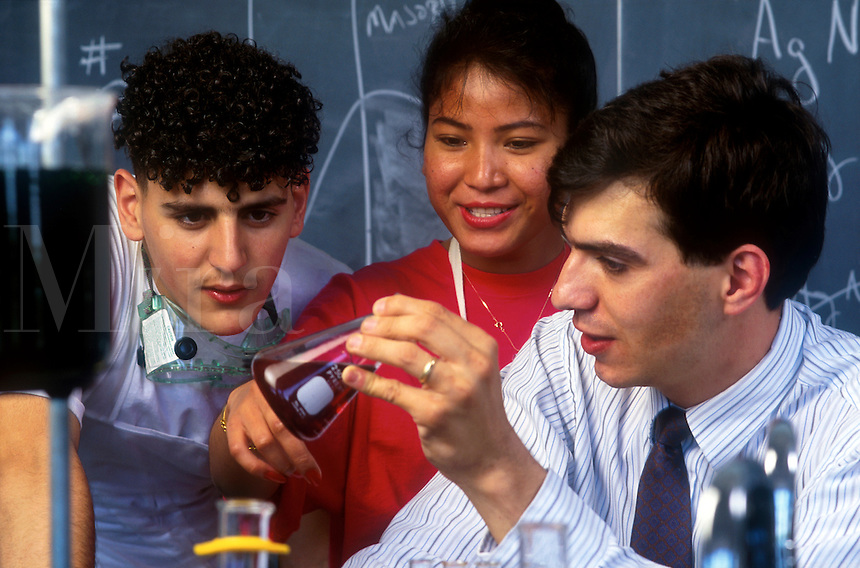 Teacher and students in chemistry class.