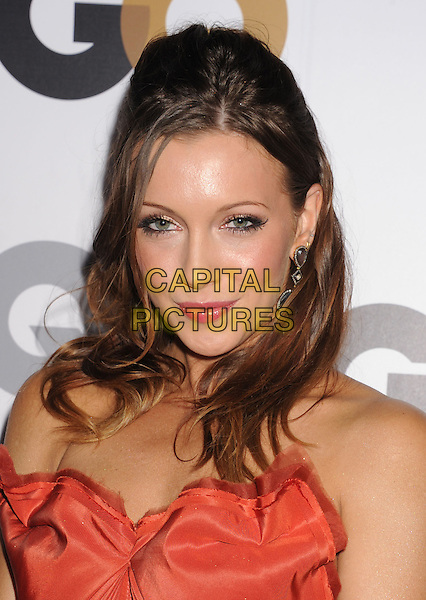 Katie Cassidy.Arriving at the GQ Men Of The Year Party at Chateau Marmont Hotel in Los Angeles, California, USA..November 13th, 2012.headshot portrait orange strapless pink lipstick .CAP/ROT/TM.©Tony Michaels/Roth Stock/Capital Pictures