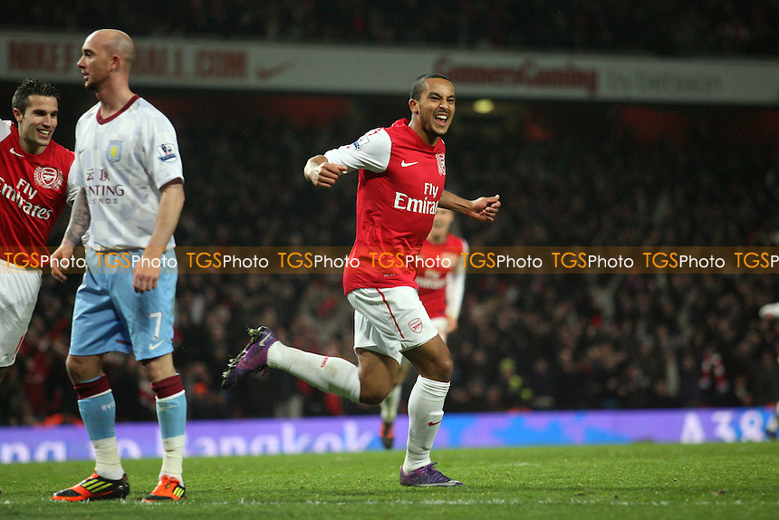 Theo Walcott of Arsenal celebrates scoring the second Gunners goal -  Arsenal vs Aston Villa - at the Emirates Stadium - 29/01/12 - MANDATORY CREDIT: Dave Simpson/TGSPHOTO - Self billing applies where appropriate - 0845 094 6026 - contact@tgsphoto.co.uk - NO UNPAID USE.