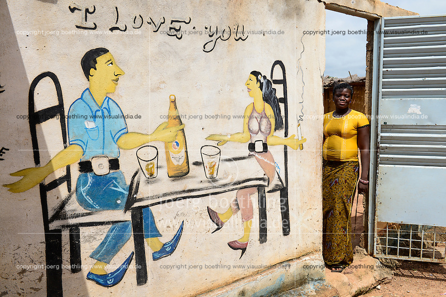 BURKINA FASO, Province Poni, Gaoua, wall painting as advertisement for beer bar, man and woman sitting at table drinking Brakina Beer, the local beer of the brewery in Burkina Faso, slogan I love you