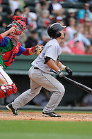 Catcher Jared Deacon (40) of the Augusta GreenJackets bats in a game against the Greenville Drive on Sunday, April 12, 2015, at Fluor Field at the West End in Greenville, South Carolina. Augusta won, 2-1. (Tom Priddy/Four Seam Images)