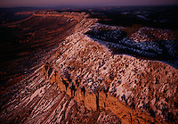 Dusted in snow, the Grand Wash Cliffs in Arizona sweep toward the million-acre Grand Canyon Parashant National Monument, one of 15 national monuments created during the Clinton administration. The remote, rugged wilderness is a protective watershed of the Grand Canyon...The Grand Wash Cliffs juxtapose the colorful, lava-capped Precambrian and Paleozoic strata of the Grand Canyon against the highly faulted terrain, recent lake beds, and desert volcanic peaks of the down-dropped Grand Wash trough.