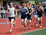 Edwardsville distance runner Roland Prenzler leads the pack in the 3200 meter run - which he won setting a new meet record - at the Collinsville Invitational Boys Track & Field Meet on Saturday May 5, 2018. Tim Vizer | Special to STLhighschoolsports.com