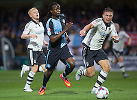 Marcus Bean of Wycombe Wanderers goes through on goal under pressure from Shaun Hutchinson of Fulham during the Capital One Cup match between Wycombe Wanderers and Fulham at Adams Park, High Wycombe, England on 11 August 2015. Photo by Andy Rowland.