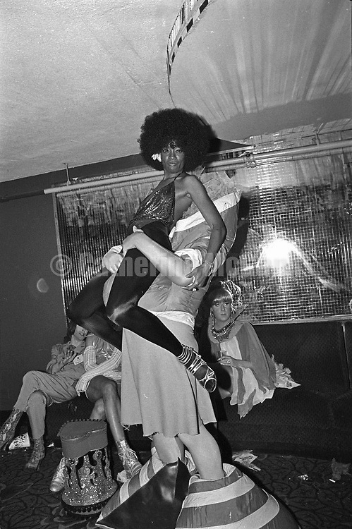 May 22, 1991:  Performance artist Leigh Bowery (1961 - 1994) poses with an African American woman with an afro at the Love Ball on May 22, 1991.