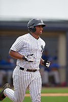 GCL Yankees East left fielder Canaan Smith (22) runs to first base during the second game of a doubleheader against the GCL Blue Jays on July 24, 2017 at the Yankees Minor League Complex in Tampa, Florida.  GCL Yankees East defeated the GCL Blue Jays 7-3.  (Mike Janes/Four Seam Images)