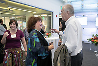 Mandy Boesche and Professor Eric Newhall.<br /> Friends, family, alumni, students, faculty and staff gather in Johnson Hall classroom 303 for the dedication of The Roger Boesche Classroom on Oct. 21, 2018. The dedication included a ribbon cutting. The gathering then went downstairs to the McKinnon Center for Global Affairs to watch a video of daughter Kelsey Boesche and to listen to remarks.<br /> Longtime Occidental College politics professor Roger Boesche, revered by generations of Oxy students and credited by President Barack Obama '83 for sparking his interest in politics, passed away on May 23, 2017.<br /> (Photo by Marc Campos, Occidental College Photographer)