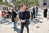 Aaron Paul walks to the food trucks outside Choi Auditorium. Paul, his wife and two of his friends came to see Jedidiah Jenkins' Tedx talk.<br />