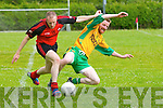 Michael Kelliher (tarbert) in action with Timmy O'Leary (Gneeveguilla) in the County Senior League at Tarbert GAA Grounds on Sunday.