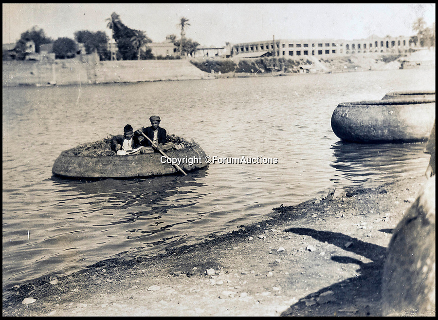BNPS.co.uk (01202 558833)<br /> Pic: ForumAuctions/BNPS<br /> <br /> A man and boy inside a basket boat.<br /> <br /> Stunning aerial photos taken by an RAF pilot who was based in northern India in the 1930s have come to light.<br /> <br /> The album of 52 photos of the North West Frontier, which today is part of modern day Pakistan, includes breathtaking snaps of the Khyber Pass and the Himalayas at 21,000ft.<br /> <br /> The pilot, who is pictured in the album and called himself 'Nuncs', also took an interest in the native population.<br /> <br /> There are snaps of a snake charmer entertaining the masses, while a father and son can be seen paddling in a traditional round basket boat on a river.