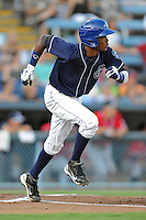 Asheville Tourists shortstop Rosell Herrera #7 runs to first during a game against the Rome Braves at McCormick Field on July 25, 2013 in Asheville, North Carolina. The Tourists won the game 9-6. (Tony Farlow/Four Seam Images)