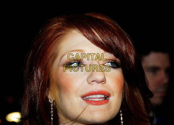 "NICOLA ROBERTS - GIRLS ALOUD.""It's A Boy Girl Thing"" World Charity Premiere, Odeon West End, London, UK..December 18th 2006.headshot portrait gold earrings.CAP/IA.©Ian Allis/Capital Pictures"