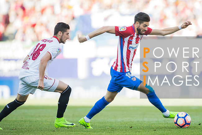 Yannick Ferreira Carrasco (r) of Atletico de Madrid runs past Pablo Sarabia Garcia of Sevilla FC during their La Liga match between Atletico de Madrid and Sevilla FC at the Estadio Vicente Calderon on 19 March 2017 in Madrid, Spain. Photo by Diego Gonzalez Souto / Power Sport Images