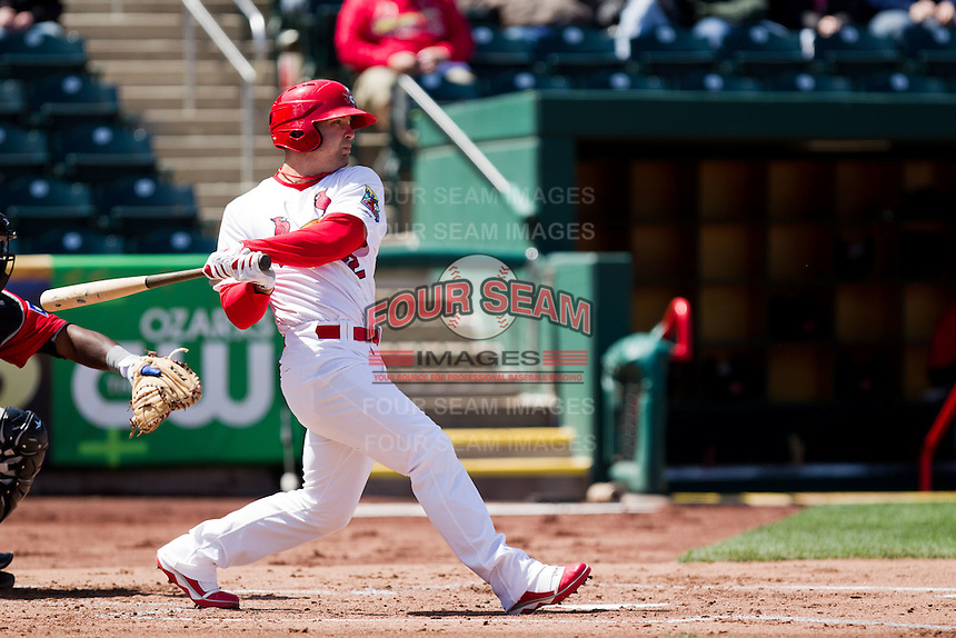 Tyler Henley (12) of the Springfield Cardinals makes contact on a pitch during a game against the Frisco RoughRiders on April 16, 2011 at Hammons Field in Springfield, Missouri.  Photo By David Welker/Four Seam Images