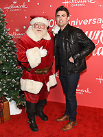 "20 November 2019 - Hollywood, California - Jonathan Bennett. Hallmark Channel's 10th Anniversary Countdown to Christmas - ""Christmas Under the Stars"" Screening and Party. Photo Credit: Billy Bennight/AdMedia"