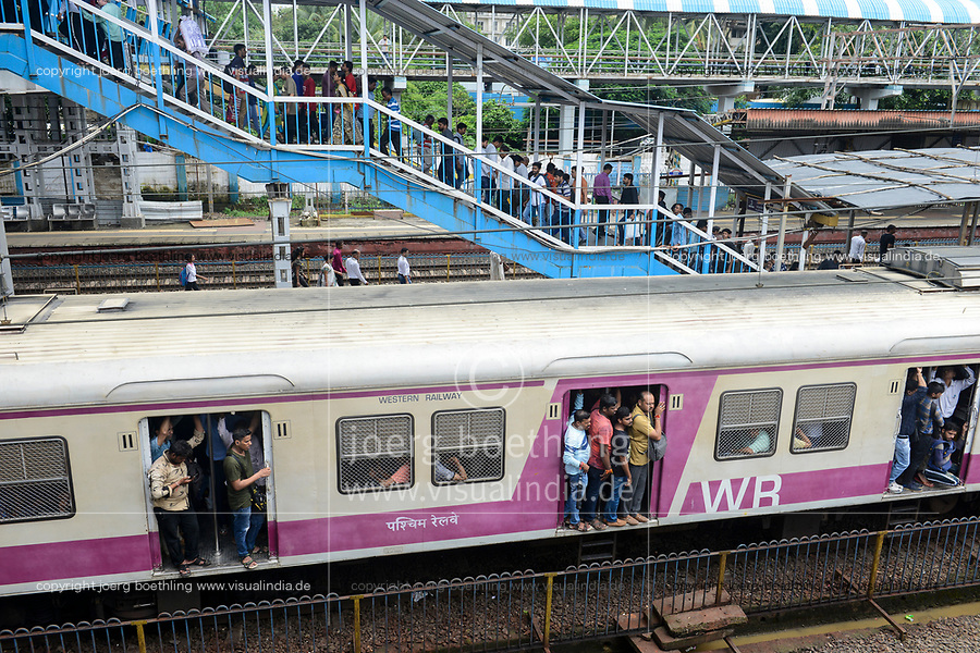 INDIA, Mumbai, suburban Malad, railway station of suburban train Western Railway WR, commuter travel between suburbans and city centre