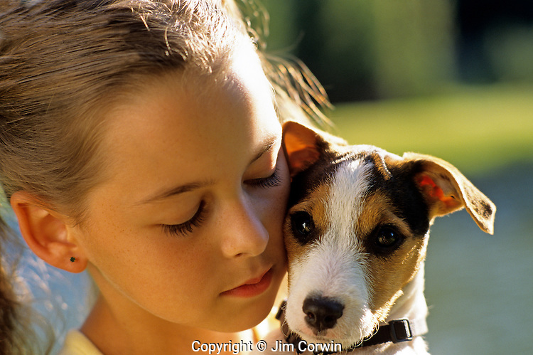Young girl holding her Jack Russell Terrier puppy