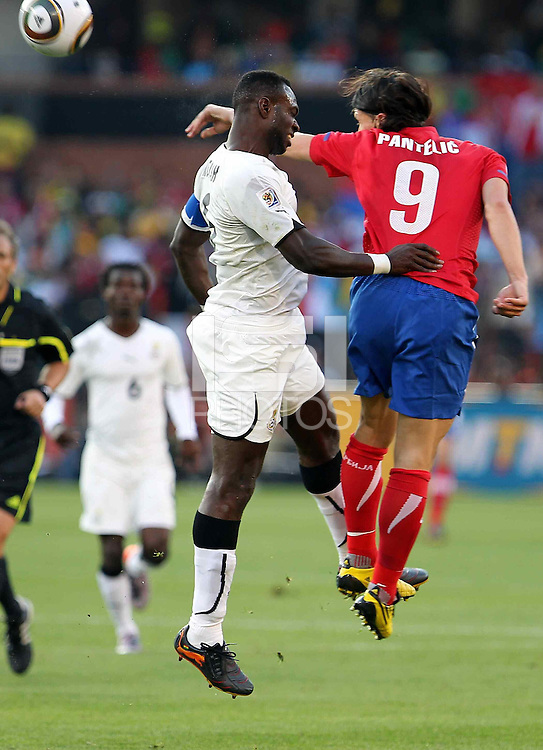 John Mensah (L) of Ghana and Marko Pantelic (R) of Serbia